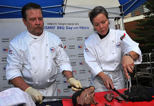 Chefs James Fischer and Rebecca Fischer provide a cooking and cutting demonstration