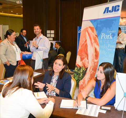 Buyers gather information on U.S. pork products at the AJC International booth
