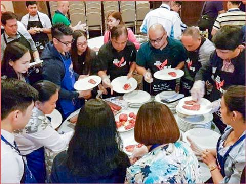 Chefs, restaurant owners and foodservice managers study cuts of U.S. red meat during a USMEF culinary training camp in the Philippines