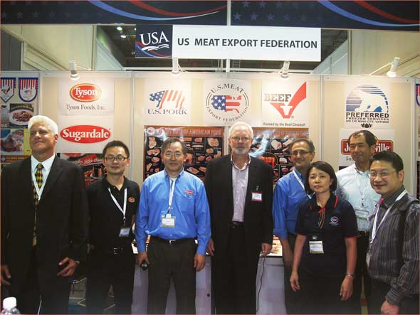 U.S. Ambassador to Vietnam David Shear (fourth from left) visits the USMEF booth at Food & Hotel Vietnam 2013