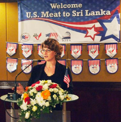 Allison Areisa, counselor of economic and commercial affairs at the U.S. Embassy in Sri Lanka, welcomes guests to the USMEF trade reception