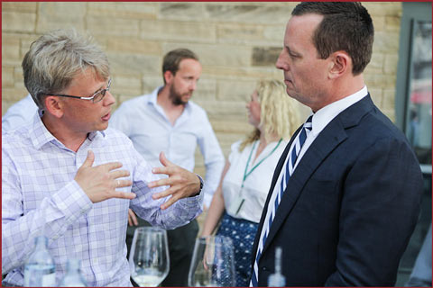 USMEF representative Yuri Barutkin, left, speaks with U.S. Ambassador Richard Grenell at a reception held at the U.S. Embassy in Berlin for restaurant owners, chefs, importers, distributors and journalists