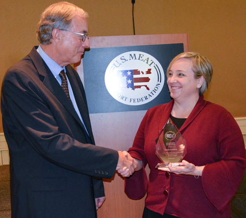 Anne Dawson, senior trade advisor with FAS, received the 2017 USMEF Distinguished Service Award from USMEF Past Chair Roel Andriessen