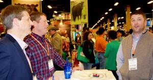 (From left) Greg Hanes and Mark Jagels speak with Lodgepole, Neb., rancher John Widdowson at USMEF's trade show booth