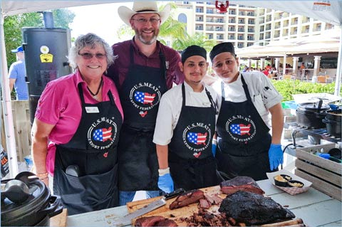 USMEF's Liz Wunderlich and pit master Bryan Bracewell (in cowboy hat) set up a Texas-style barbecue on the beach as part of the Aruba promotion