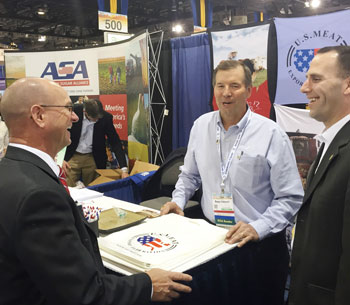 USMEF Vice-chair Bruce Schmoll (center) speaks with Alan Tiemann (left), a member of the Nebraska Corn Board from Seward, Nebraska, and Kelly Brunkhorst, executive director of the Nebraska Corn Board, at the Commodity Classic trade show