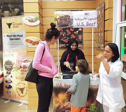 Shoppers at the Butcher's Block in Seeb, Oman, sample U.S. beef at in-store promotions conducted by USMEF
