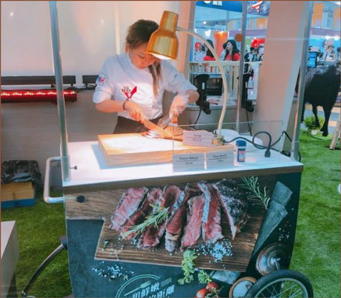 """Tasting samples of U.S. beef were available at USMEF's booth, which centered around the """"Farm to Table"""" theme"""
