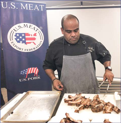 Chef Alonso Williams demonstrates proper cooking of U.S. pork ribs for staff members of HRI companies in Panama