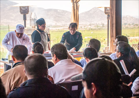 USMEF chef German Navarrete explains the preparation and grilling of U.S. beef and pork cuts during a cutting and cooking seminar in Ensenada, Mexico
