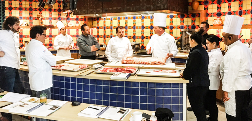 A team of chefs from Mexico and the Dominican Republic looks on during a cutting demonstration organized by USMEF at the Culinary Institute of America in San Antonio, Texas