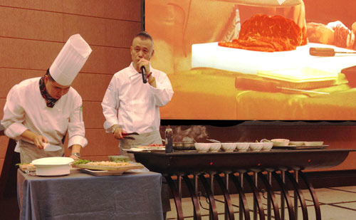 Master Chef Charles Lai (right) conducts a cooking demonstration at a U.S. pork seminar in Beijing