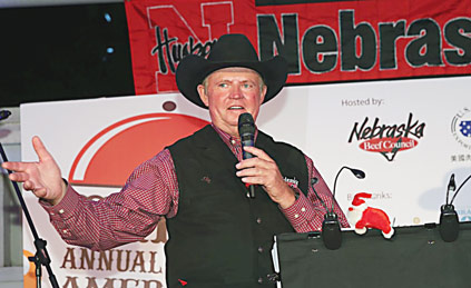 "Nebraska rancher Chris Abbott addresses the audience at the third annual ""Nebraska in Macau"" barbecue event"