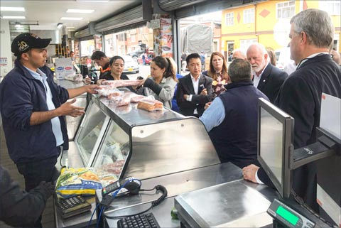 U.S. pork producers and industry leaders visit a retail meat counter in Colombia to explore the variety of cuts and products available