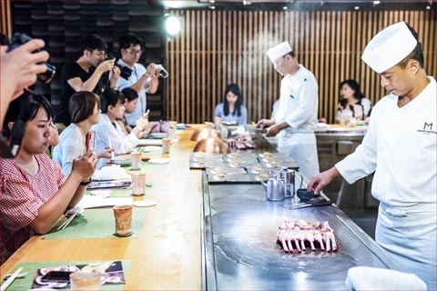 Taiwanese journalists document chefs' preparation of U.S. lamb at one of three tasting luncheons in Taipei hosted by USMEF