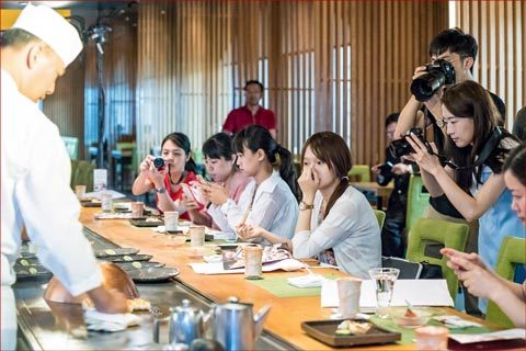 Journalists sample U.S. lamb and photograph a cooking demonstration at tasting luncheons in Taipei
