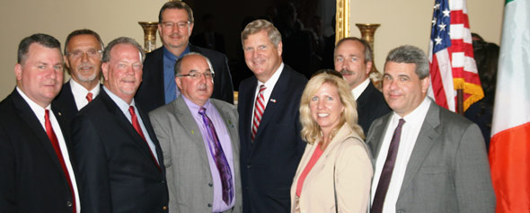 Front row, from left: John Hinners, Gary Marshall, Jim Zook, U.S. Agriculture Secretary Tom Vilsack, Laura Knoth and Cary Sifferath. Back row, from left: Don Hutchens, Craig Floss and Rodney Weinzierl