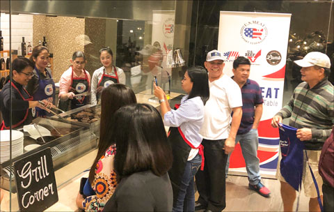 Participants learn how to grill U.S. beef on the first day of the culinary training camp in the Philippines