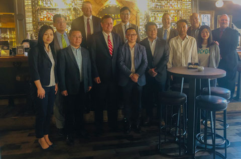 U.S. Sen. Steve Daines (front row, third from left) discussed U.S. beef and pork trade with Chinese food industry representatives during a meeting in Beijing organized by USMEF
