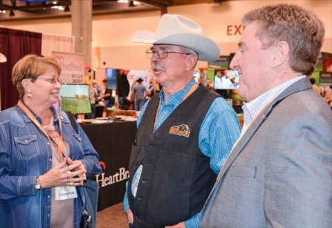 South Dakota cattle producers Wanda Blair, a member of the USMEF Executive Committee, and Ed Blair speak with USMEF President and CEO Dan Halstrom at the NCBA Trade Show in Phoenix