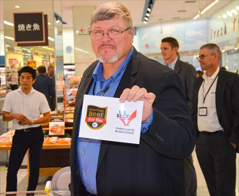 David Merrell of the Nebraska Corn Board with one of the U.S. beef promotional cards available at a supermarket meat case