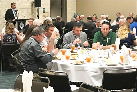 Dean Meyer, co-chair of the USMEF Feedgrain and Oilseed Caucus, gives opening remarks at a luncheon thanking corn and soybean producers for being partners in ongoing international marketing programs