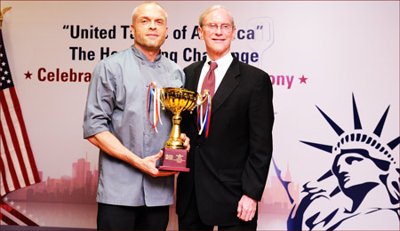 Stephen Young (right), U.S. Consul General in Hong Kong, presents the Asian Chef Challenge winner's trophy to chef Eyck Zimmer of Derby Restaurant