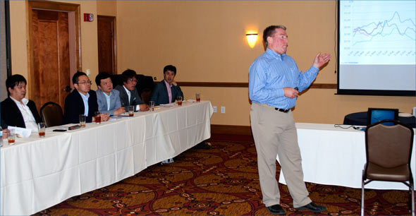Dan Halstrom, USMEF senior vice president for marketing and communications, provides a team of executives from Hannan Foods Group with an overview of the U.S. pork and beef markets