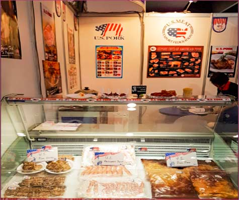 USMEF's display case at Fine Food Australia featured U.S. pork pre-cooked bacon and pulled pork