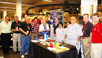 The Market Expo team observes a U.S. beef tasting demonstration at Supermarket El Rey in Panama City