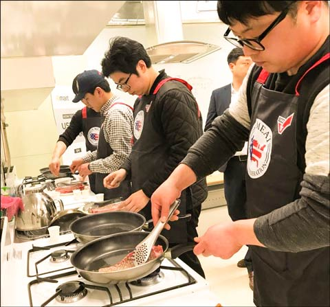 E-Mart meat department managers in Korea receive instruction on how to prepare thick-cut U.S. steaks