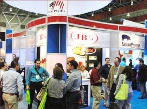 Meat industry representatives gather at the USMEF pavilion at Expocarnes 2013 in Monterrey, Mexico