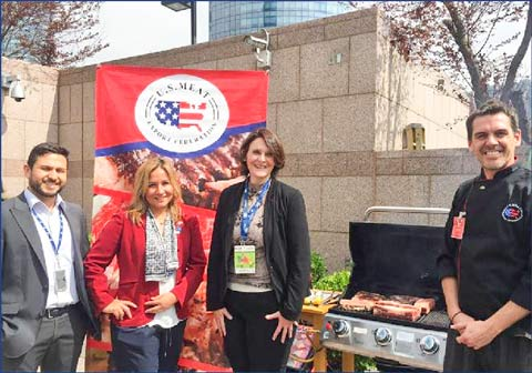 (left to right) Sergio González, Marcela Rondón and María José Herrera of the USDA Foreign Agricultural Service (FAS) office in Santiago pause for a photo with USMEF Chef Nicolas Diaz during a Chilean Independence Day luncheon at the U.S. Embassy