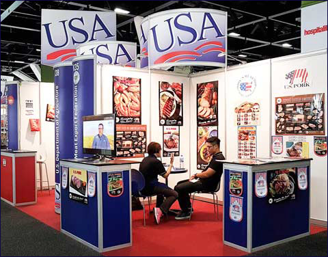 USMEF staff prepares for a day of promoting U.S. pork in the USA Pavilion at Fine Food Australia