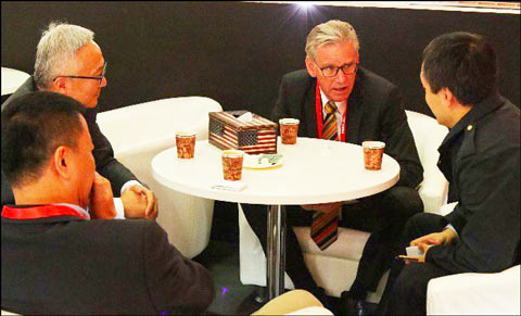 Joel Haggard, USMEF senior vice president for the Asia Pacific, meets with buyers at the USMEF booth at Food and Hotel China