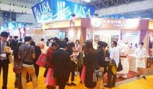 A large crowd of visitors gathers at the USMEF booth during FOODEX Japan 2016