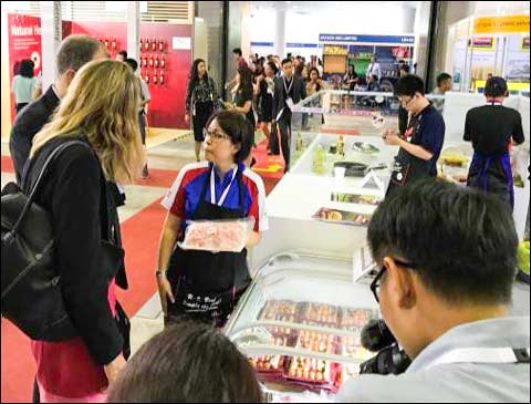 Sabrina Yin (center), USMEF director in the ASEAN region, answers question about U.S. red meat products during Food and Hotel Vietnam