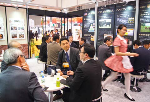 Buyers and traders discuss U.S. beef and pork inside the USMEF section of the USA Pavilion at FoodEx 2017 in Japan