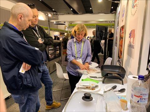 Visitors to the USMEF booth sampled many U.S. pork products, including pre-cooked bacon and pulled pork