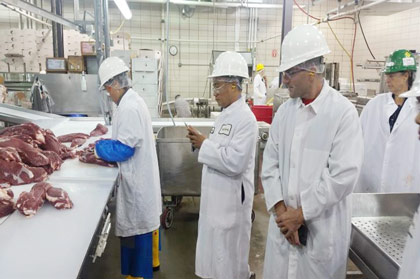 Seminar participants inspect meat products at the University of Wisconsin Meat Laboratory in Madison, Wisconsin