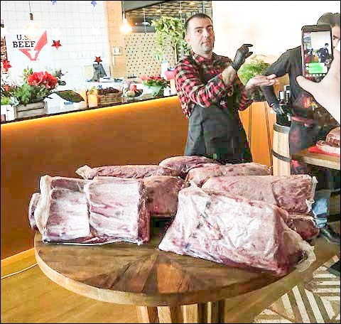 Chef Chef Kharazishvili describes the quality and many uses for the cuts on display