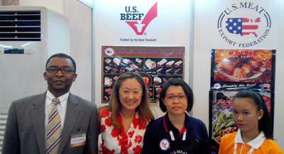 Gerald Smith, senior agricultural attaché in Cambodia (far left), visited the USMEF booth