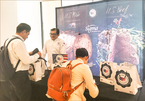 USMEF Corporate Chef German Navarrete greets visitors at the USMEF booth at a casual dining event in Monterrey, Mexico, organized by Sigma Foodservice, an importer of U.S. red meat