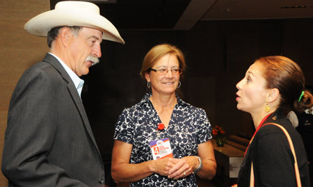 Nebraska cattle producers Rod and Laura Gray speak with Veronica Leon Macias, international sales manager for Northern Beef Industries, Inc.  Rod Gray is a member of the Nebraska Beef Council Board of Directors