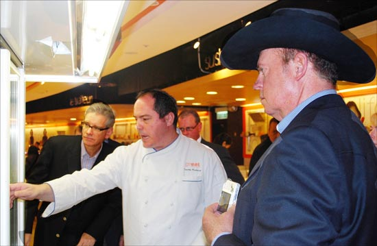 Timothy Broderick, executive chef at the Great Food Hall in Hong Kong, discusses meat selections with Joel Haggard (left), USMEF Senior VP for the Asia Pacific region, Nebraska Beef Council Member Chris Abbott (right) and Illinois Soybean Association board member Mark Sprague (background)