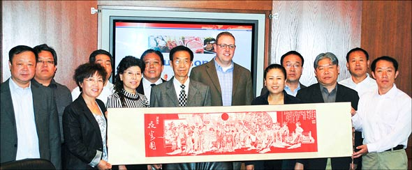 USMEF technical services manager Travis Arp with livestock officials from China's Hebei province
