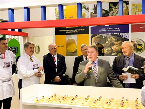Joined by USDA Under Secretary of Agriculture for Trade and Foreign Agricultural Affairs Ted McKinney (far left), USMEF President and CEO Dan Halstrom promotes U.S. beef to guests and visitors at the Taste of the USA pavilion at Gulfood 2018