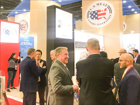 Exporters and buyers gather at the USMEF booth at the 24th edition of Gulfood