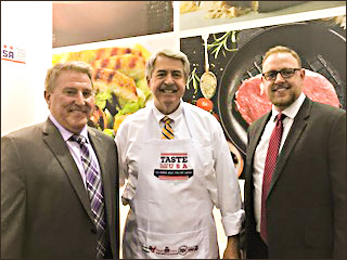 USDA Under Secretary of Agriculture for Trade and Foreign Agricultural Affairs Ted McKinney (center) is flanked by USMEF President and CEO Dan Halstrom (left) and USMEF Director of Market Access and Export Services Travis Arp at Gulfood 2018