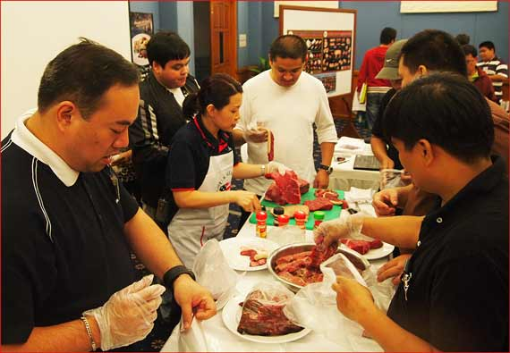 Sabrina Yin and chef Alex Chong instruct seminar participants